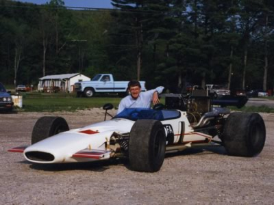 Mike Allison poses with his McLaren M10B at Lime Rock in 1988. Copyright Mike Allison 2010. Used with permission.