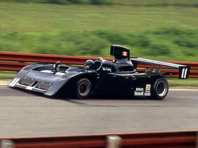 Mike Freberg in his Lola T530 at Mid-Ohio in 1982. Copyright Terry Capps  2014. Used with permission.
