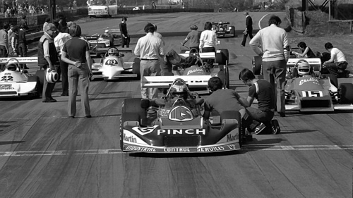 Phil Dowsett sits in his March 81A on the front row of the Grid at Oulton Park, April 1981.  No 22 is Richard Hawkins in the Ralt RT1, No 3 is Ian Taylor's Tiga FA81, partly obscured behind Dowsett is Mark Thatcher in the Ehrlich RP5A and the No 15 is the sister Ehrlich RP5B of Ian Flux.  Copyright Alan Cox 2010.  Used with permission.