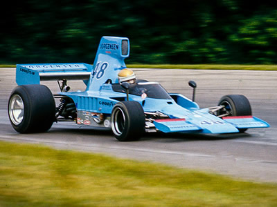 Vern Schuppan in AAR's Lola T332 at Mid-Ohio in 1976. Copyright Richard Deming 2016. Used with permission.
