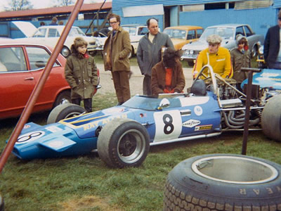 Ray Allen's McLaren M18 draws a crowd in the Mallory Park paddock in 1972.  Copyright Stuart Dent 2004.  Used with permission.