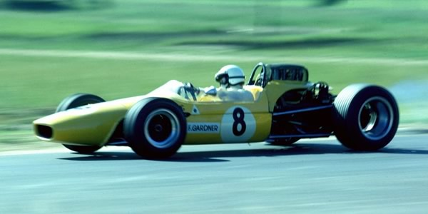 Frank Gardner in the Brabham BT23D with Alfa Romeo V8 engine at Warwick Farm in 1968.  Copyright John Ellacott 2008.  Used with permission.