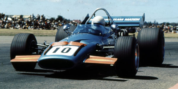 Frank Matich in his Repco-Holden-engined McLaren M10B during the 1971 Tasman series.  Copyright Ted Walker (Ferret Fotographics) 2012.  Used with permission.