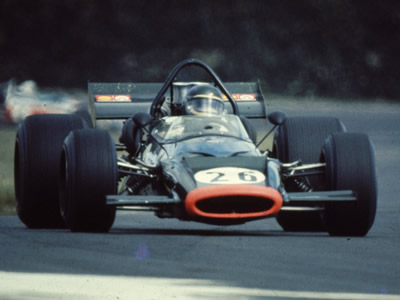 Neil Allen in his McLaren M10B.  The location has not been identified. Copyright Ted Walker (Ferret Fotographics)  2012. Used with permission.