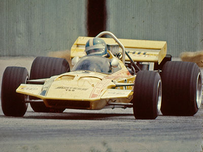 Mike Eyerly in the Bonphil Racing Surtees TS8 during the Tasman series in early 1971.  The Hangar doors in the background suggest this is at Wigram. Copyright Ted Walker (Ferret Fotographics)  2012. Used with permission.