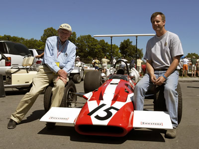 Mark Harmer poses with John Surtees and his restored Surtees at Road America in the summer of 2003. Copyright Mark Harmer  2003. Used with permission.