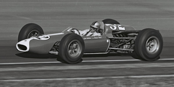 Jack Brabham in the Brabham BT12 at Indy in 1964.  Part of the Dave Friedman collection. Licenced by The Henry Ford under Creative Commons licence Attribution-NonCommercial-NoDerivs 2.0 Generic. Original image has been cropped.
