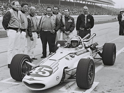 Johnny Rutherford in the Eagle with the Weinberger Homes crew at the 1967 Indy 500. Licenced by The Henry Ford under Creative Commons licence Attribution-NonCommercial-NoDerivs 2.0 Generic. Original image has been cropped.
