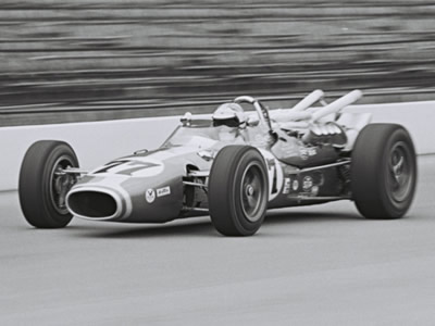 Bruce Jacobi in George Walther's Dayton Steel Brake Gerhardt at the Indy 500 in 1967.  Part of the Dave Friedman collection. Licenced by The Henry Ford under Creative Commons licence Attribution-NonCommercial-NoDerivs 2.0 Generic. Original image has been cropped.