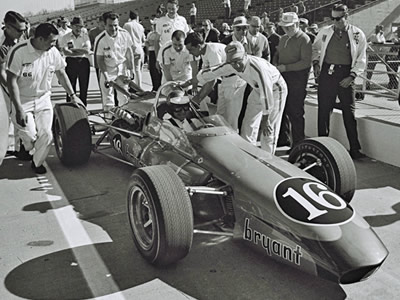 Len Sutton prepares for practice in the 1965 Vollstedt at that year's Indy 500. Part of the Dave Friedman collection. Licenced by The Henry Ford under Creative Commons licence Attribution-NonCommercial-NoDerivs 2.0 Generic. Original image has been cropped.
