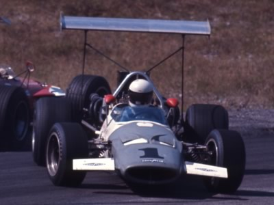 Sam Posey getting tangled up in his McLaren M10A at Mosport Park in August 1969. Copyright Thomas Horat  2011. Used with permission.