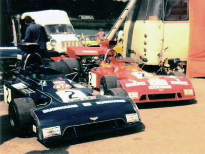 Tony Dean's two Chevron B24s at Mallory Park in July 1974: the blue car is his original B24-73-01 and the red car is the ex-Gethin 'B24-73-08'. Copyright Simon Lewis 2004. Used with permission.