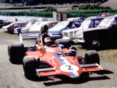 Peter Gethin's T400 HU4 being taken through the Mallory Park paddock in 1975. Copyright Simon Lewis  2004. Used with permission.