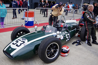 Scotty Taylor waits with his Cooper T53 at the 2017 Silverstone Classic. Licenced by David Merrett under Creative Commons licence Attribution 2.0 Generic (CC BY 2.0). Original image has been cropped.