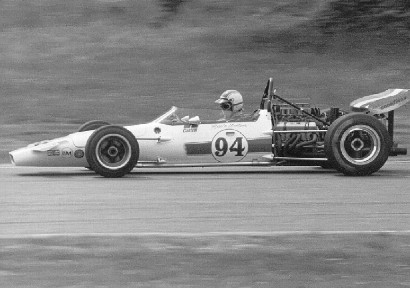 Eppie Wietzes in his McLaren M18 at Laguna Seca in 1971.  Copyright Al Moore 2002.  Used with permission.