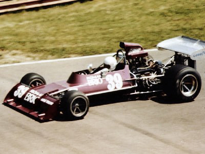 John Gunn's 73A in its Roman Brio livery at (probably) Mid-Ohio. Copyright Drake Moore  2004. Used with permission.