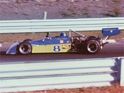 Howdy Holmes in his Chevron B27 at Watkins Glen in October 1974. Copyright Allen Brown (slide acquired on eBay)  2019. Used with permission.
