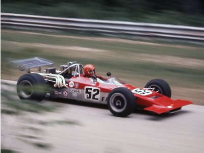 Pete Sherman in his #52 red Lola T192 at Road America in 1971. Copyright Richard A Reeves 2013. Used with permission.