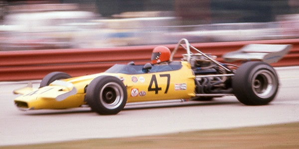 Evan Noyes in his new McLaren M18 at Road America in 1971.  Copyright Richard A Reeves 2013.  Used with permission.