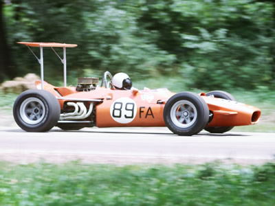 John Hood's oddly orange Lola T140 at Blackhawk Farms in July 1969. Copyright Tom Schultz  2006. Used with permission.