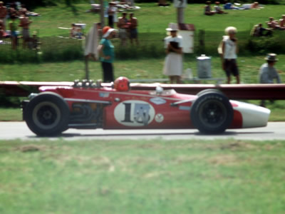 Brian O'Neill's red Lola T140 in the Badger 200 at Road America in 1968. Copyright Tom Schultz  2006. Used with permission.