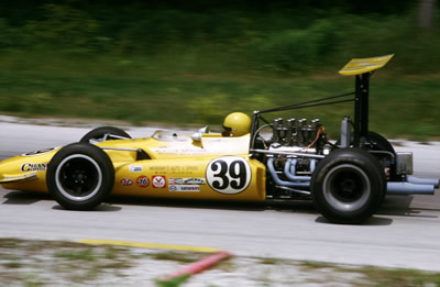 Another 'Golden Yellow' Lola T142, this one with John Gunn aboard at Road America in July 1969.  Copyright Tom Schultz 2006.  Used with permission.