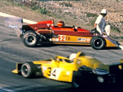 Tom Crowther pointing the wrong way in his Falconer-bodied March 722 at Westwood in May 1975, as Tom Pumpelly passes by in the foreground. Copyright Kevin Skinner 2020. Used with permission.