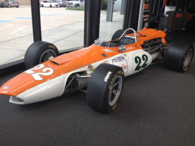 Wally Dallenbach's 1966 Eagle in the lobby of <a href=http://unserkarting.com/ target=_blank>Unser Karting</a> in July 2014. Copyright Unser Karting  2014. Used with permission.