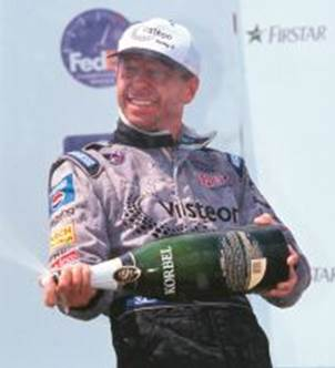 Roberto celebrates after winning at Cleveland in 2000.